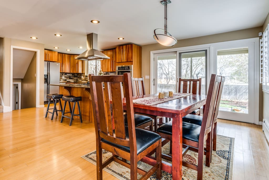 We love this home! Open main floor is great for hosting large groups. There is seated inside/outside dining for 18 guests.