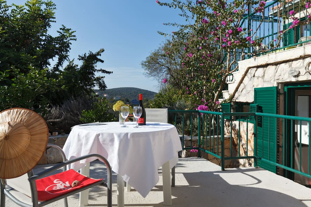 Terrace where you can relax, with view to the landscape and the sea.