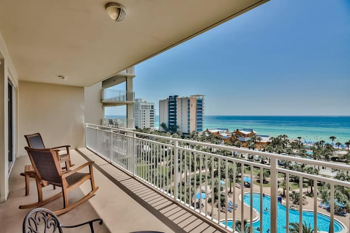 7th floor condo with ocean views, shared pool, central AC, and washer/dryer!