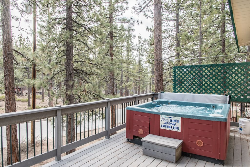 Sink into a bubbling hot tub on your private deck.