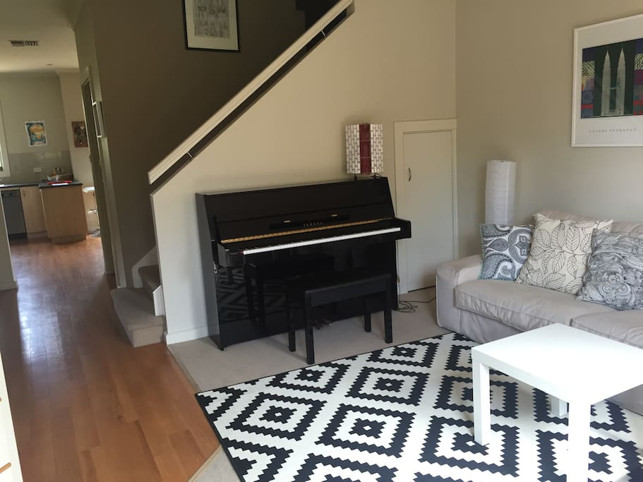 Comfortable sitting room with piano.