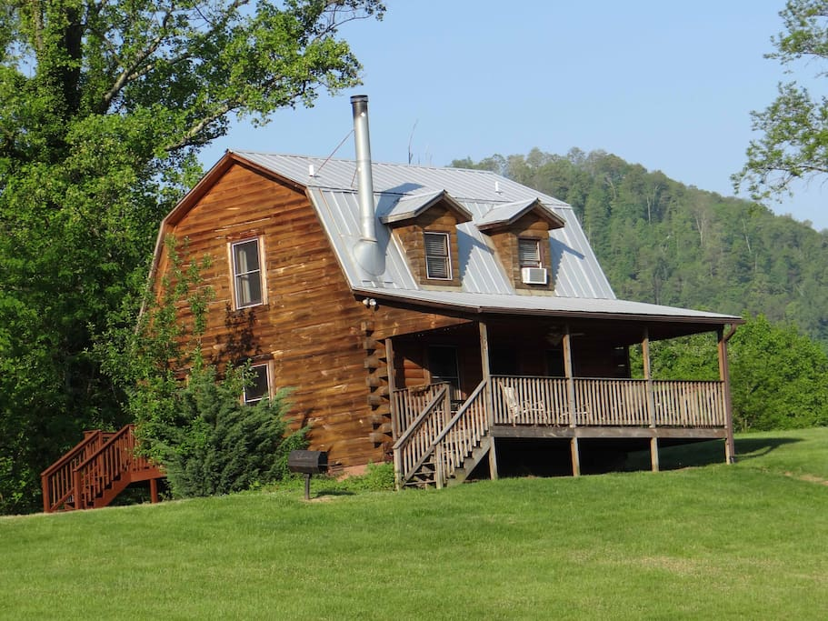 This is the view of the side deck and entrance to the Mount Mitchell Cabin.