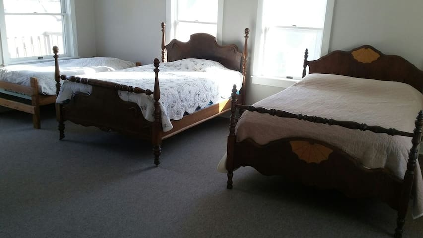 Upstairs bedroom showing the two full beds and the other single bed.