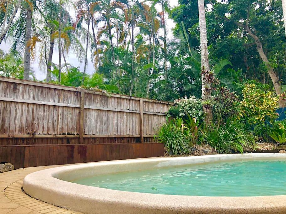 Villa pool, tropical gardens & Main Street access.