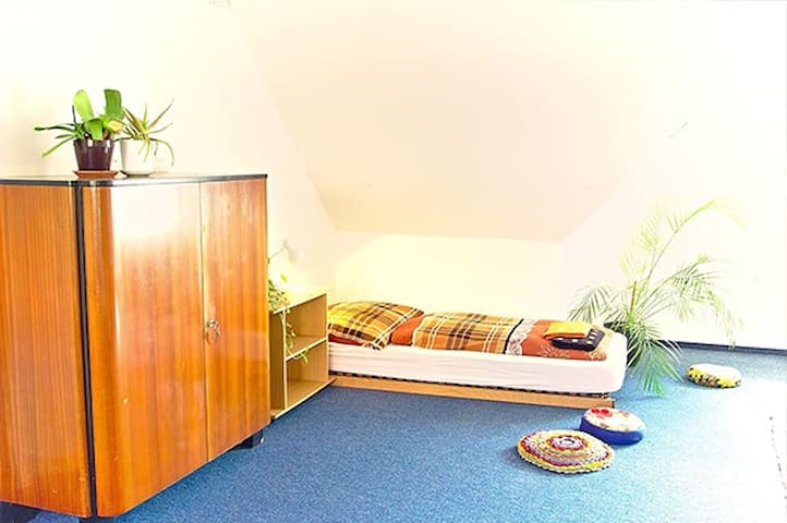 Bed in a large shared attic of Vila Flora (bed #2)