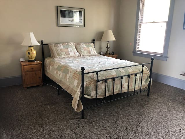 Larger bedroom with queen bed