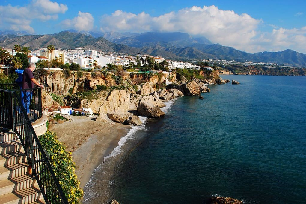 View of Nerja coves from the famous Balcon de Europa, Nerja scenic promenade to the Mediterranean blue sea.