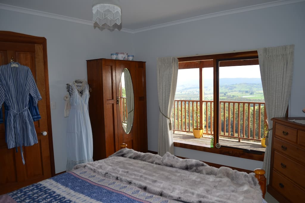You may not want to close the curtains because the views are fantastic and its easy to snuggle in this bedroom while just looking out at the environment around you....