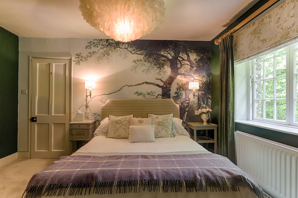Bedroom with king size bed and en suite shower room