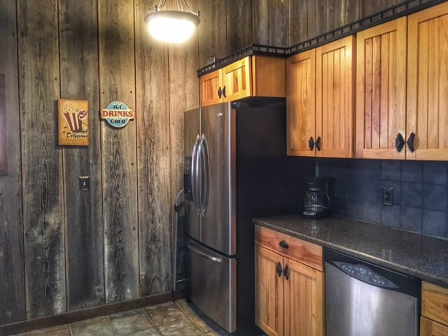 the kitchen includes a refrigerator, stove, microwave and dishwasher and comes fully stocked with dishes, silverware, pots and pans, cooking utensils, coffee pot, a few basic pantry items and more