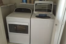 Washer/dryer across from room entrance.