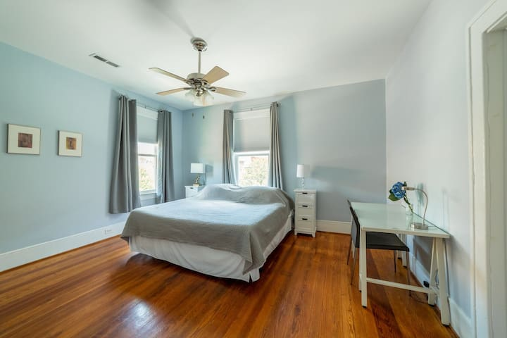 The blue bedroom has a king Tempurpedic bed, organic cotton bedding, a desk & chair, night tables & a serene feel. Twelve foot ceilings & original hardwoods are throughout the entire apartment. Each bedroom has light blocking drapes for dark sleeps.