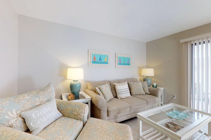 Elegant beach condo with a community heated pool and great location!