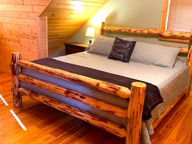 The second guest bedroom with a king log bed