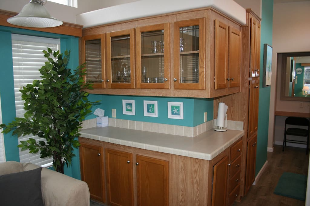 Plenty of counter space for making a meal or storing your items. Sofa also offers a good vantage point to watch tv.
