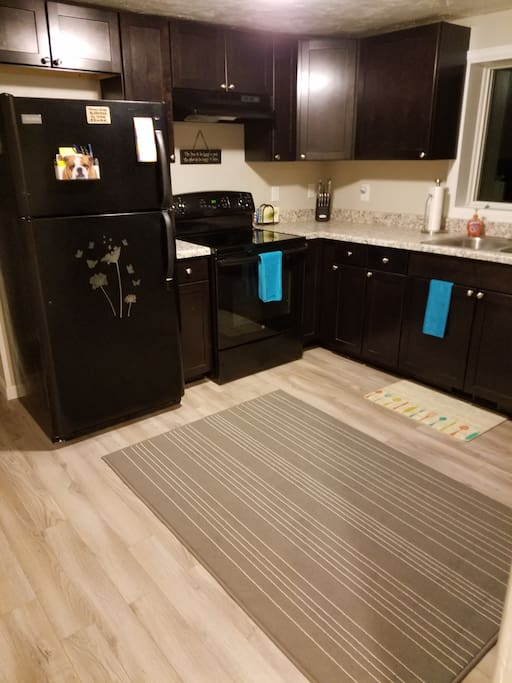 New Kitchen with dishes and utensils