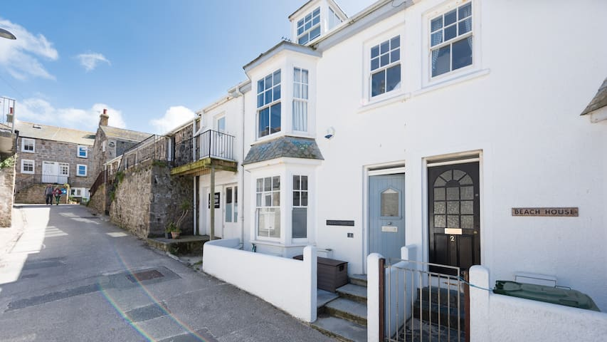1 Porthmeor Road, beach is just 30 seconds away. Super close to St Ives harbour and town too. Free WiFi