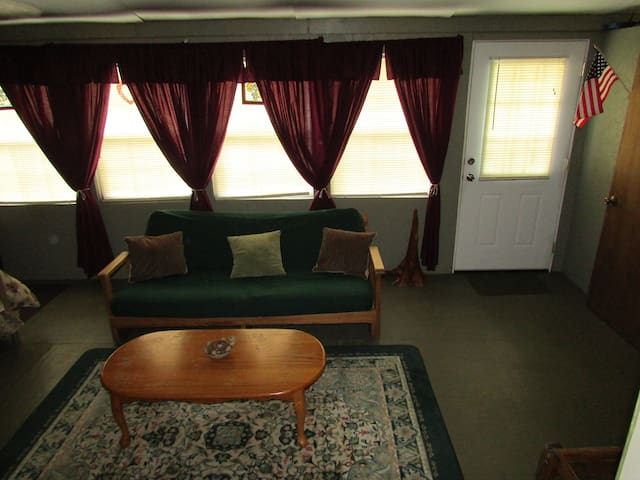 Windows with view of the bayou and a futon