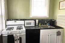 Full kitchen with gas stove, microwave, dishwasher & refrigerator