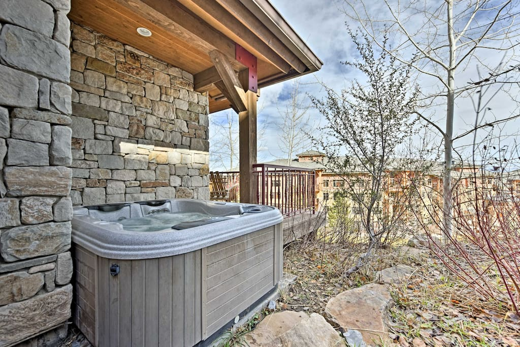 With a private outdoor hot tub and deck, this condo promises a vacation like none other!