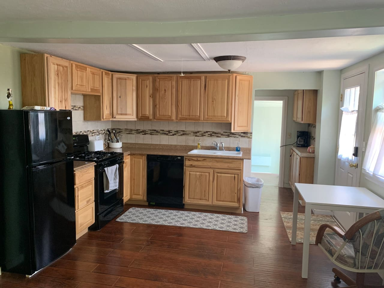 Full Kitchen with dishwasher, gas stove and fridge