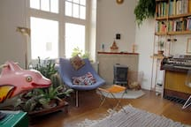 The living room with fire place, Hammond organ, plants and many, many books!