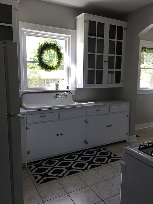 Farm sink, unfinished cabinets
