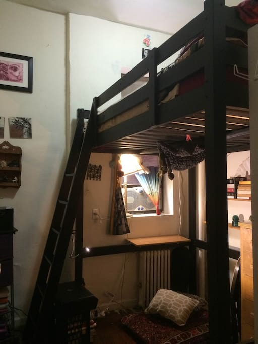 cozy bedroom with full-size loft bed