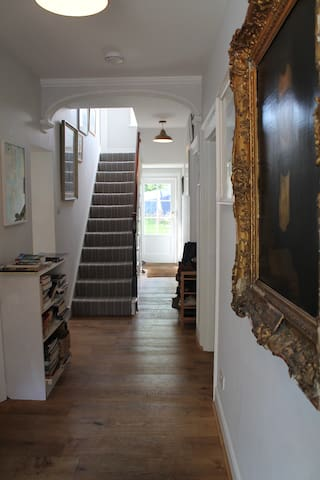 The Hall: 'Sunny Room' is up these stairs, on the left.