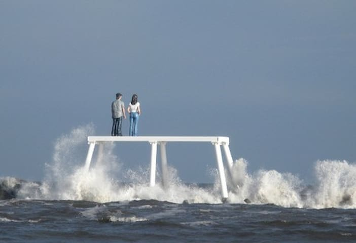 """Couple"" by Sean Henry, 2007. A large (12.25 x 21 x 6 metre) sculpture on the breakwater at Newbiggin-by-the-Sea installed on 17th August 2007. A smaller sculpture, ""Land Couple"", was installed on land in November 2007."