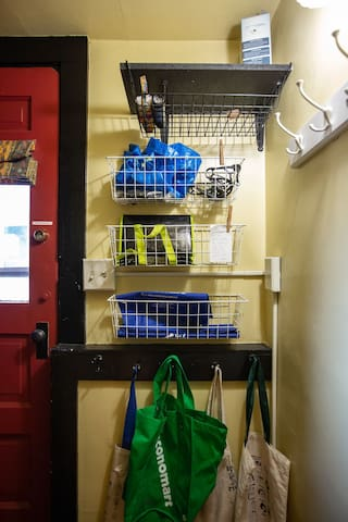 This is the coat rack and basket area by your entrance.  There is a stairway leading down to your basement level apartment.   The stairway has a good railing!   Hang your winter coats here and leave your outdoor shoes up here too if you want.