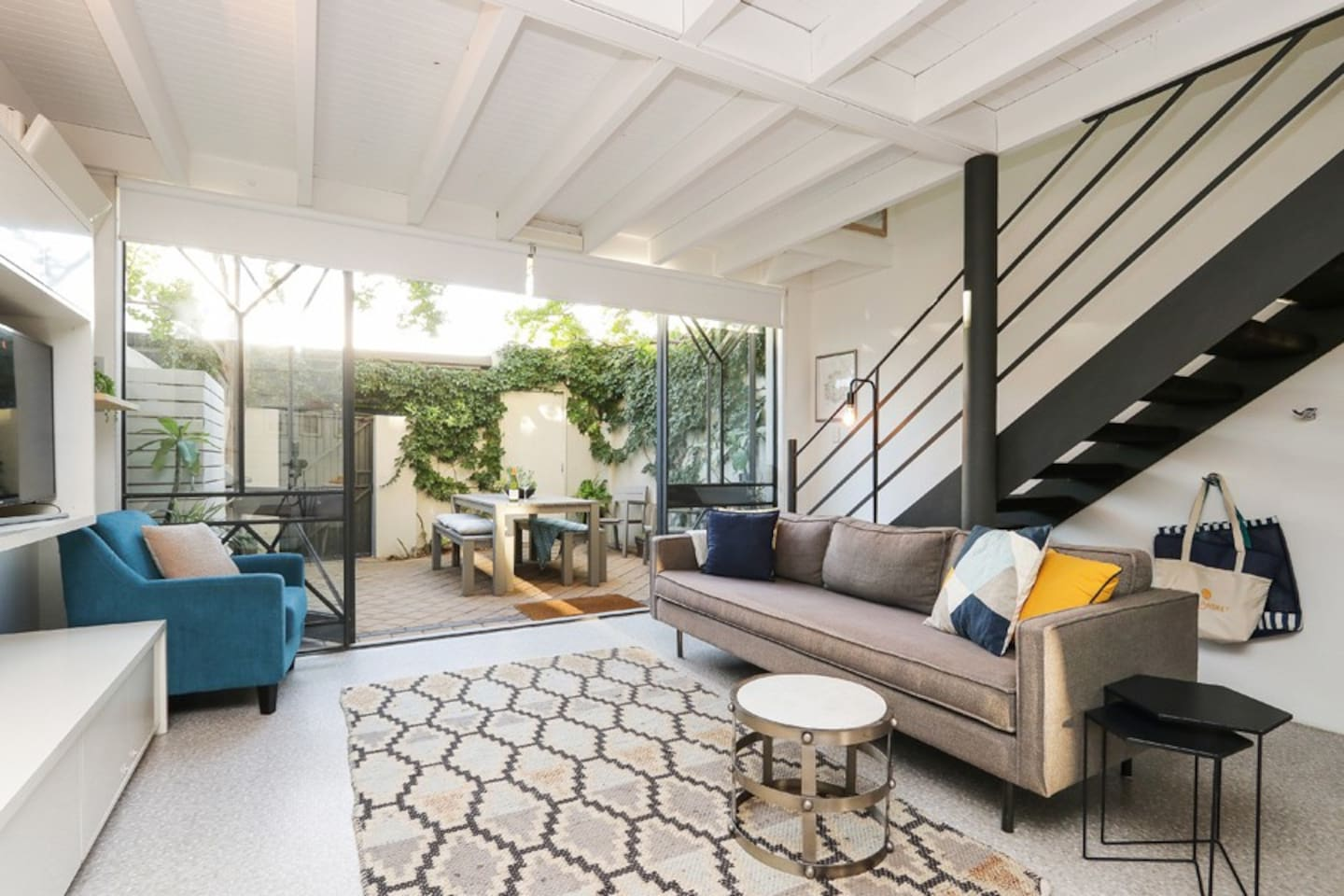 Open plan living area flows into the private courtyard (Please note the property has just been painted so the vine in the courtyard has been removed and replanted)
