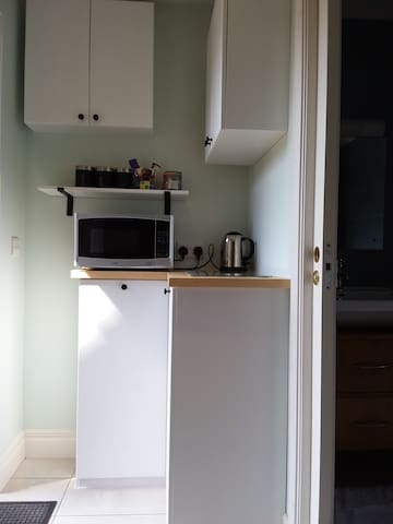 Kitchenette with Tea/Coffee, kettle, microwave, sole use of fridge in garage, next door