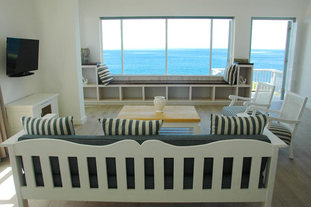 living room with 180 degree sea view and luxury furniture including flat screen tv