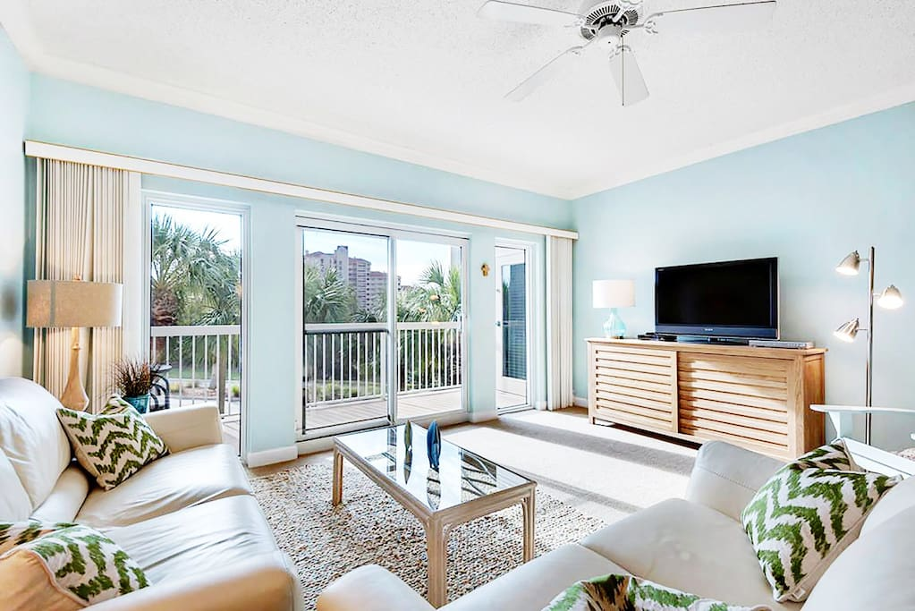 Flat screen and balcony view in living area!