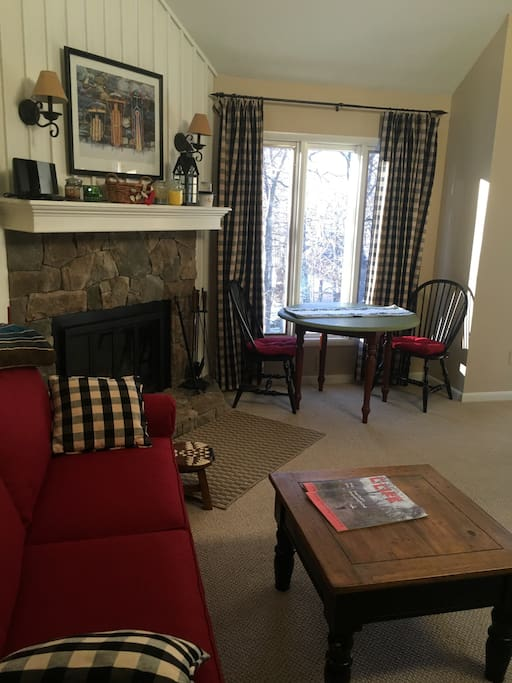 A comfortable living area with a fireplace to keep you warm after the day is done. There are extra chairs for the table in the bump out room. Firewood is stocked by the Association, so you will not run out.