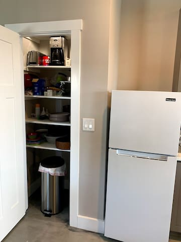 Lots of countertop appliances, waffle, toaster, coffee, and more.