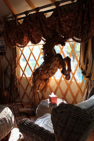 The stallion is part of the interior decor is made from pieces of teakwood.