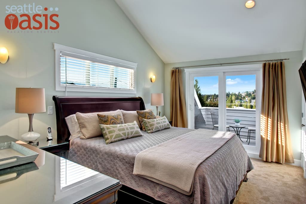 The master bedroom has a private balcony with great views of Seattle.