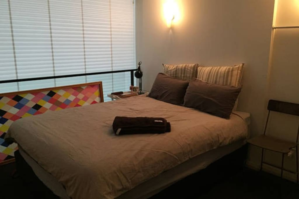 Queen bed with ample storage space.