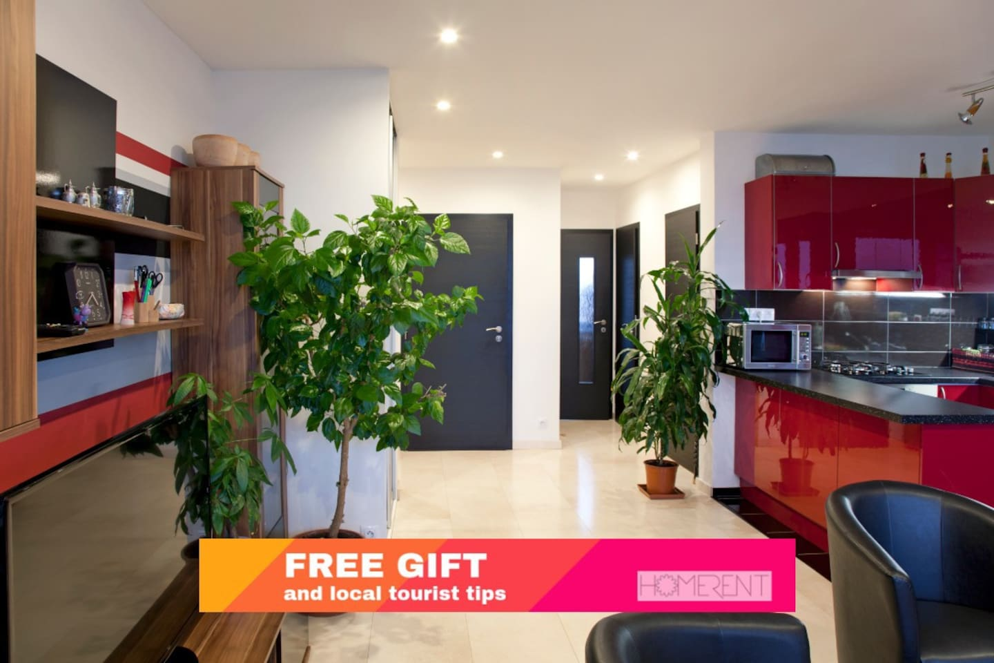 MODERN and SPACIOUS apartment with a charming red kitchen and enough space for 8 people!
