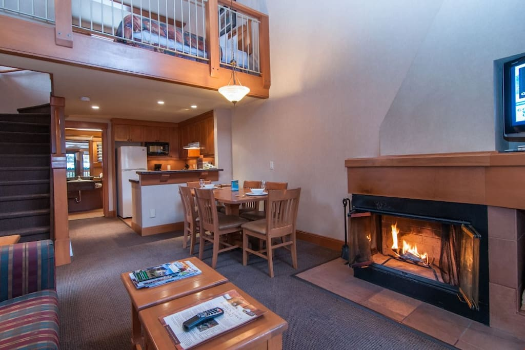 Share laughs with your group by the majestic wood-burning fireplace (firewood included).