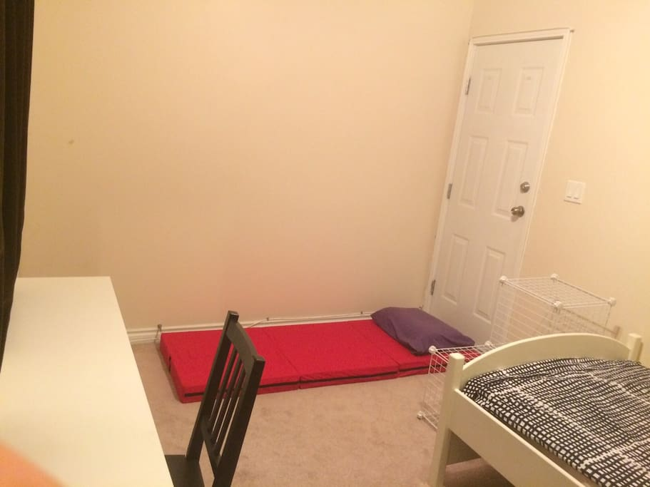 """3"""" futon mattress ready for 2nd traveler at no additional cost."""
