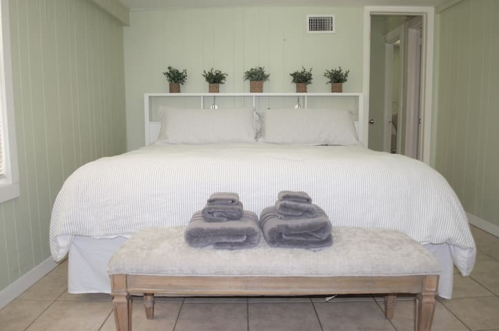 Comfortable king-size bed in master