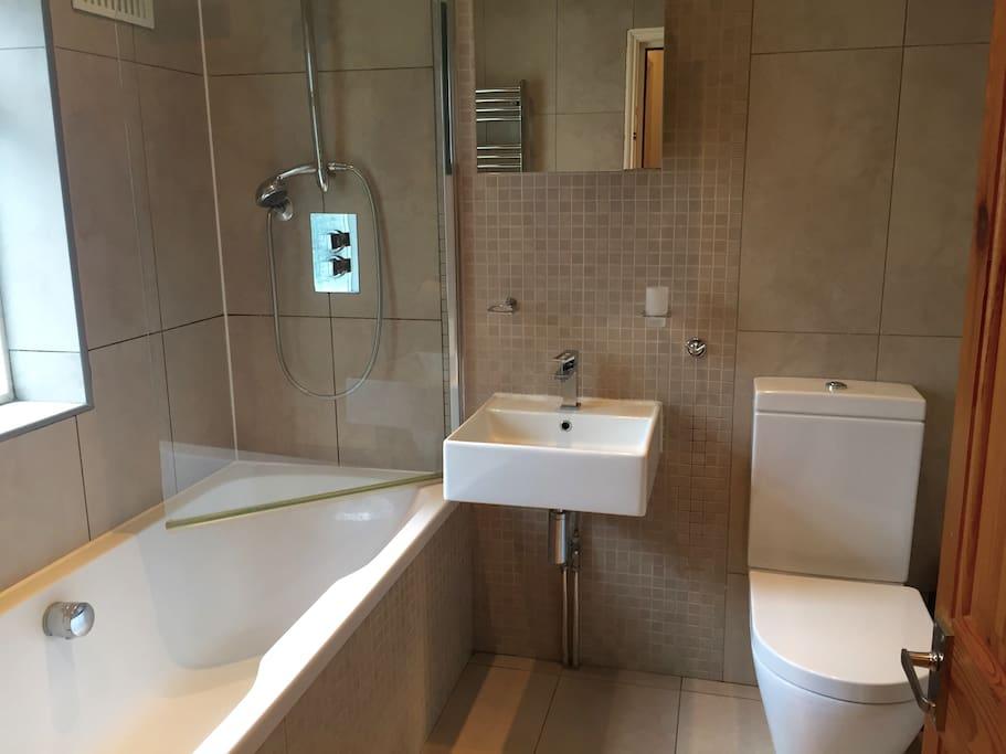 Lovely tiled bathroom in neutral decor