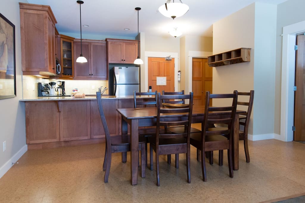 Enjoy meals together at the large wooden dining table