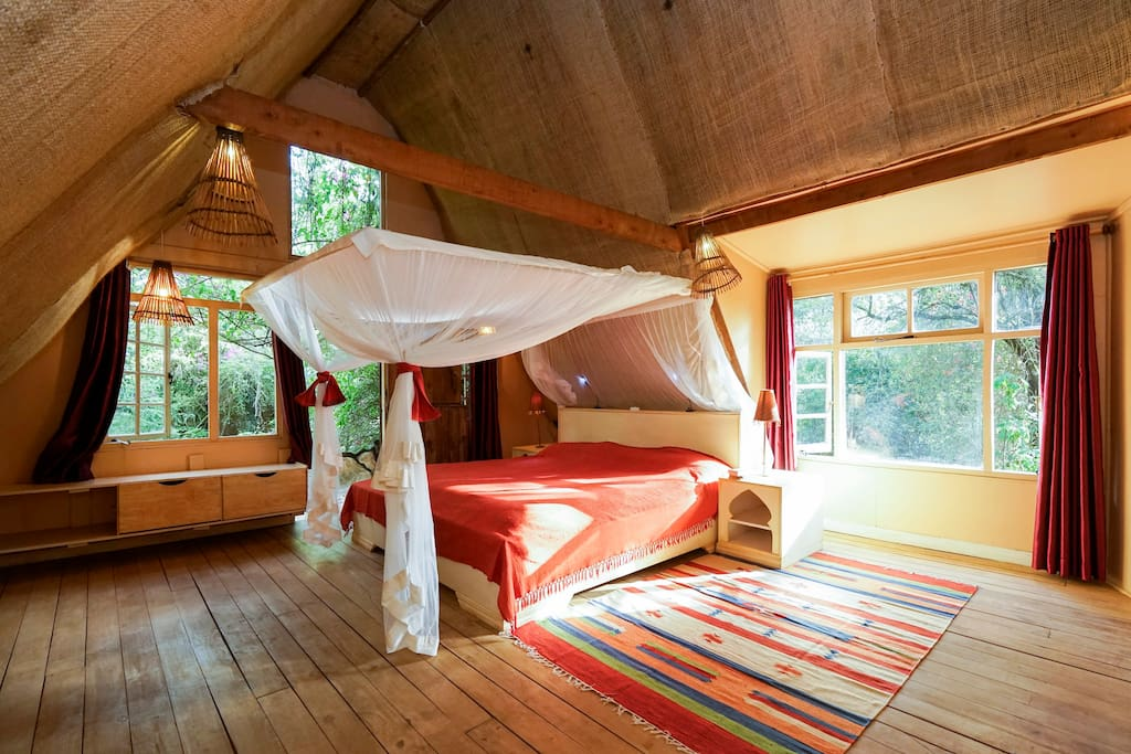 Main bedroom. It opens out into a sweet tree-balcony.