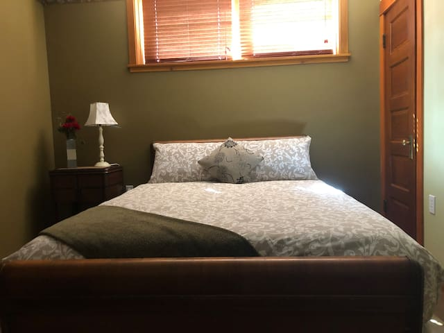 This 2nd bedroom has a  comfy and deluxe queen sized bed.