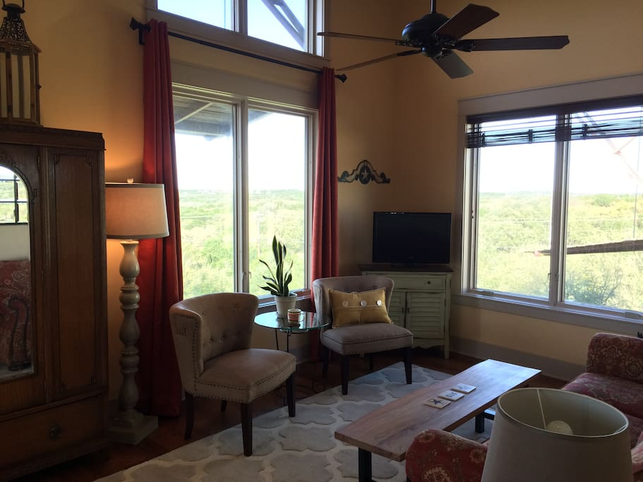 Large windows offer expansive Hill Country views