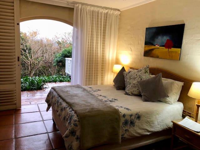 Main Bedroom leading onto Patio